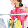 Stylish young girl trying on clothes — Foto Stock