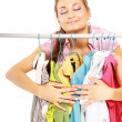 Stylish young girl trying on clothes — Stok fotoğraf