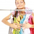 Stylish young girl trying on clothes — Stockfoto