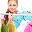 Stylish young girl trying on clothes — Stock Photo