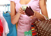 Close-up of young woman paying for her purchases — Stock Photo