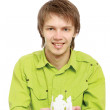 Stock Photo: Young guy taking care of paper people
