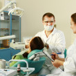 Young woman with dentist in a dental surgery — Stock Photo #36500873