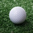 Golf ball on green grass — Stock Photo #36504287