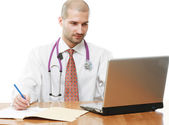 A male doctor at his workplace — Stock Photo