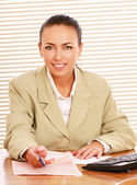Portrait of businesswoman at her workplace — Stock Photo