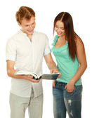 Young college boy and girl with book — Stock Photo