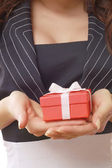 Female hands holding a gift — Stock Photo