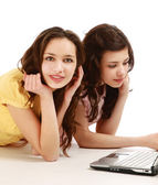 Two girls twins with laptop isolated on the white — Foto de Stock