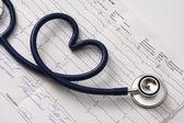 A blue stethoscope on a cardiogram — Stock Photo