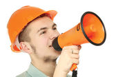 A young construction worker with a loudspeaker — Foto de Stock