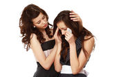 A young girl crying and a friend calming her — Stock Photo