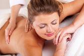 Woman receiving massage — Stock Photo