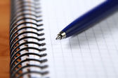 Pen on a spiral notebook — Stock Photo