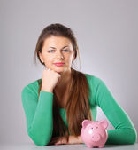 Young beautiful woman with piggy bank — Stock Photo