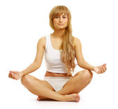 A young woman doing yoga — Stock Photo