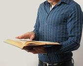Male hands are browsing through the open book — Stock Photo