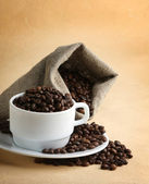 A sack of coffee beans and a cup — Stock Photo