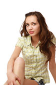A young pretty girl sitting on the floor — Stock Photo