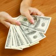 Female hands holding dollars — Stock Photo #37905767