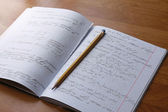 Mathematics in notebook — Stockfoto