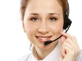 Primer plano de una niña sonriente de servicio al cliente — Foto de Stock