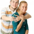 Happy young couple holding a key — Stock Photo #38022229