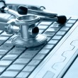 Stethoscope on silver laptop — Stockfoto