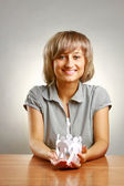 A young woman holding paper people — Stock Photo