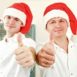Happy doctors in red santa hat showing thumbs up. — Stock Photo