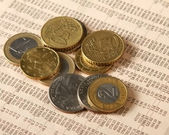 Money: euro coins and bills close up. — Stock Photo
