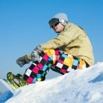 Snowboarder sitting on a ski slope. — Stock Photo #38660241