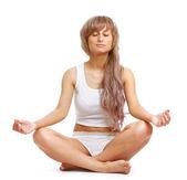 A woman practising yoga — Stock Photo