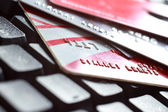 Close-up of a keyboard and credit cards — Stock Photo