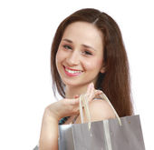 A portrait of a smiling woman with a bag, — Stock Photo