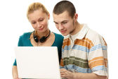 A couple with a laptop — Stock Photo