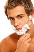 A shaving handsome man — Stock Photo