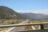 View of mountains and a road from the bridge — Стоковое фото