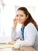 A smiling female doctor has a rest — Stock Photo