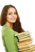 A smiling woman holding books — Foto Stock