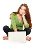 A smiling woman with a laptop — Stock Photo