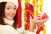Close-up of smiling woman with gift — Stock Photo
