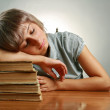 Young woman sleeping on stack of books — Stock Photo