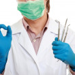 A dentist with tools, showing ok — Stock Photo