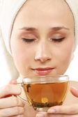 Young woman enjoying tea — Stock Photo