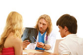 Young couple at doctor's isolated — Stockfoto
