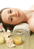 Woman relaxing at spa salon — Stock Photo