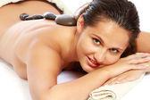 Relaxed young woman getting spa treatment — Stock Photo
