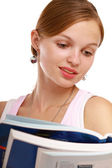 Close-up of young woman reading book — Stock Photo