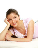 Happy teenage girl laying on sofa — Stock Photo